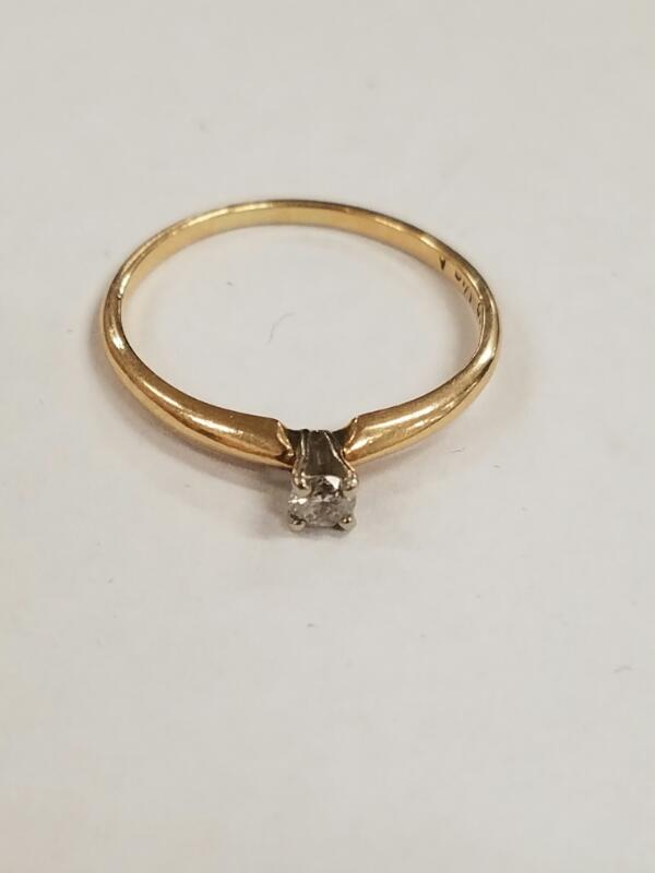 Lady's Diamond Solitaire Ring .11 CT. 14K Yellow Gold 1.3g