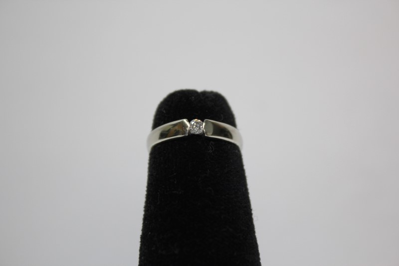 Lady's Diamond Solitaire Ring .08 CT. 14K White Gold 1.4g Size:3