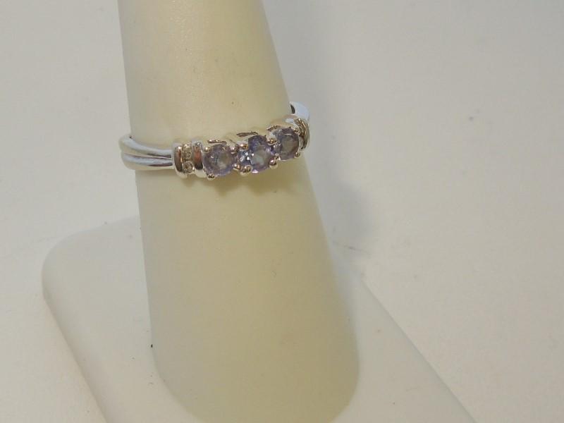 Synthetic Tanzanite Lady's Stone & Diamond Ring 4 Diamonds .020 Carat T.W.