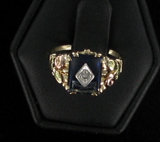 Blue Stone Lady's Stone & Diamond Ring .05 CT. 10K Yellow Gold 2.1dwt