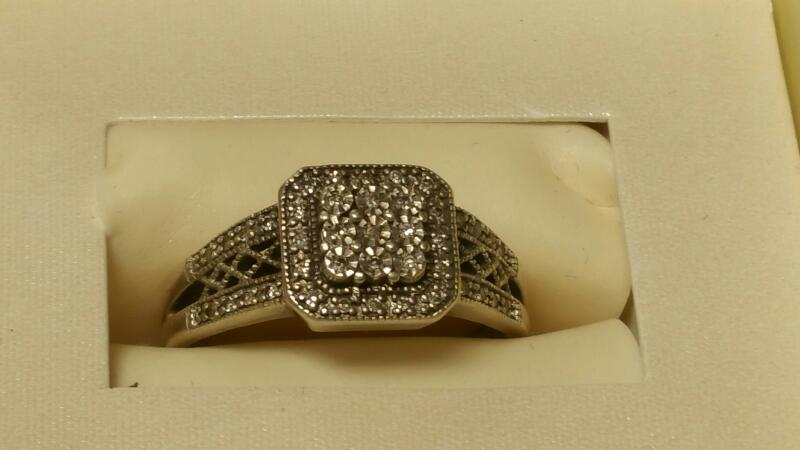 Lady's Silver-Diamond Ring .01 CT. 925 Silver 2.6dwt