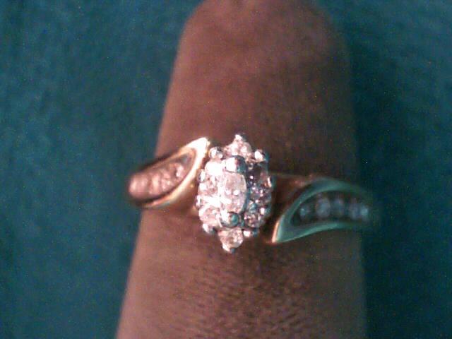 Lady's Diamond Fashion Ring 11 Diamonds .13 Carat T.W. 10K Yellow Gold 1.3dwt