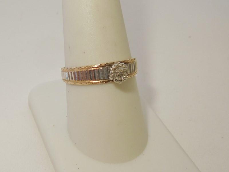 Lady's Diamond Solitaire Ring 7 Diamonds .035 Carat T.W. 10K 2 Tone Gold 2.5g