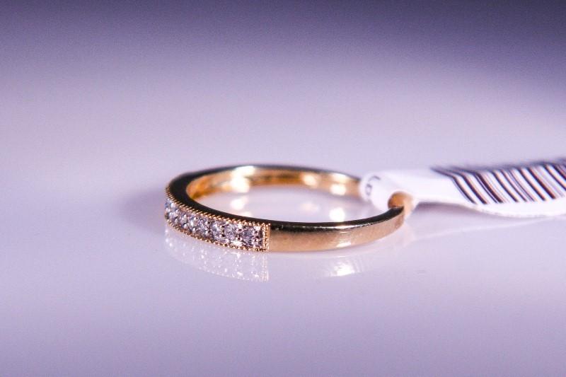 Lady's Diamond Wedding Band 12 Diamonds .12 Carat T.W. 10K Yellow Gold 1.2g