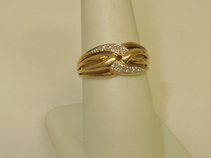 Lady's Diamond Fashion Ring 8 Diamonds .08 Carat T.W. 10K Yellow Gold 3.1g