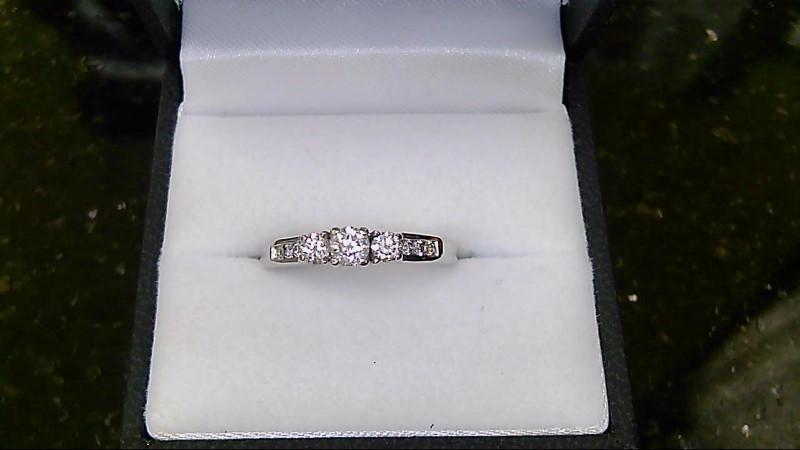 lady's 14k white gold round diamond ring