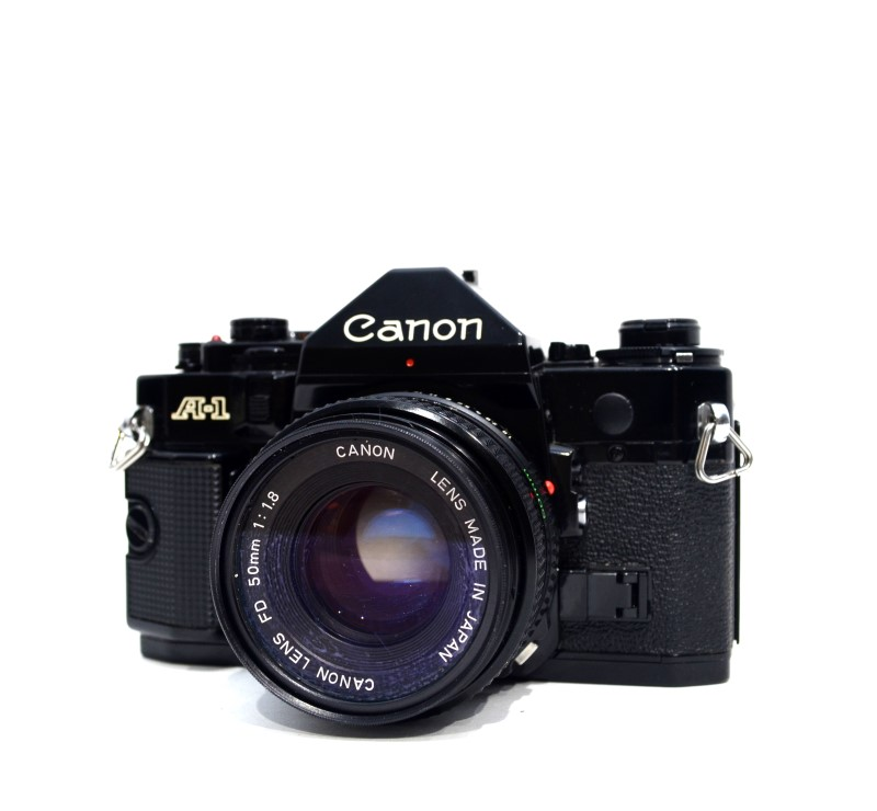Canon A-1 35mm Film SLR Camera Bundle AS IS Two Lenses and Flash>