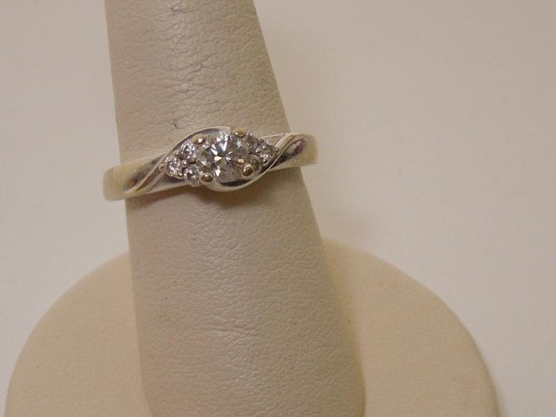 Lady's Diamond Solitaire Ring 7 Diamonds .49 Carat T.W. 14K White Gold 3.9g