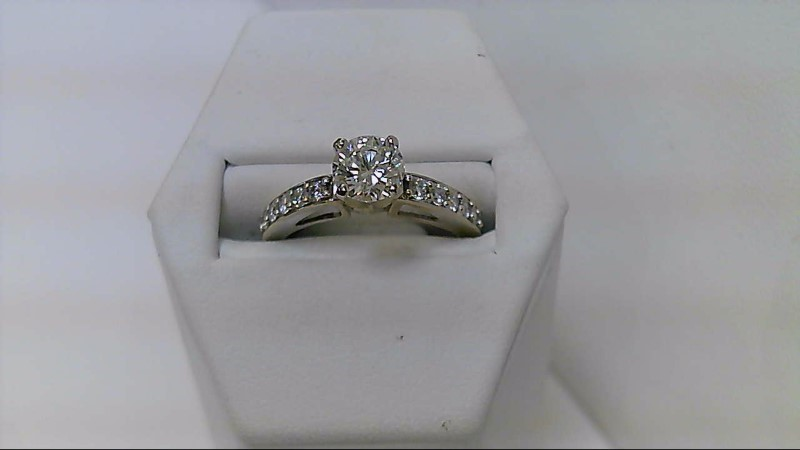 lady's 14kwg .73ct (H-I1) round dia with 1/3ctw rd side dia ring, 3.32g