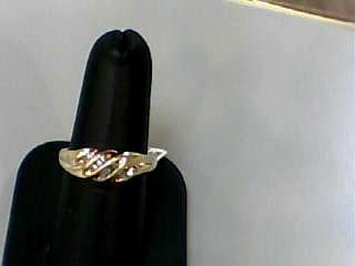 Lady's Diamond Fashion Ring 12 Diamonds .12 Carat T.W. 10K Yellow Gold 2.1dwt