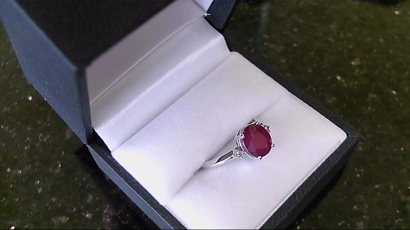 Lady's 14k white gold oval geniune ruby diamond ring
