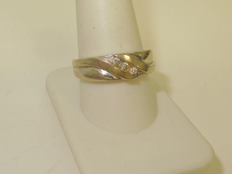 Lady's Diamond Wedding Band 3 Diamonds .09 Carat T.W. 10K White Gold 8.7g