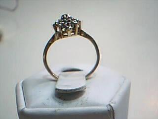 Lady's Diamond Cluster Ring 9 Diamonds .09 Carat T.W. 10K Yellow Gold 1.9g