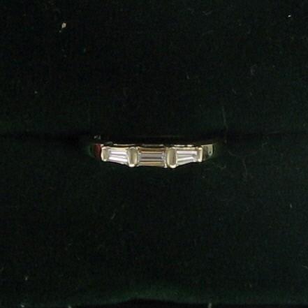 Lady's Diamond Wedding Band 3 Diamonds .45 Carat T.W. 14K Yellow Gold 1.5dwt