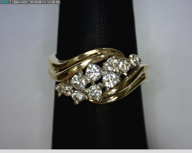 Lady's Diamond Cluster Ring 10 Diamonds .31 Carat T.W. 14K Yellow Gold 3.34dwt