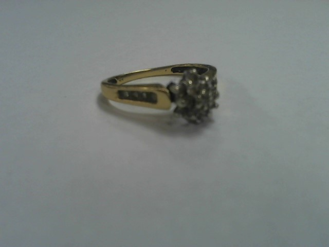 Lady's Diamond Cluster Ring 12 Diamonds .12 Carat T.W. 14K Yellow Gold 2.2g