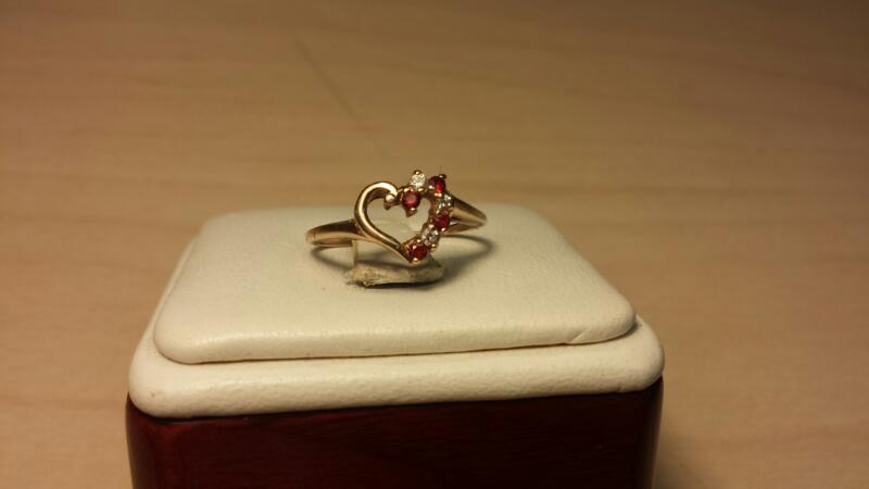 10k Yellow Gold Ring with 3 White and 4 Red Stones - .9dwt - Size 7