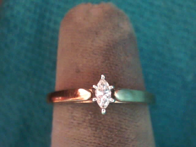 Lady's Diamond Solitaire Ring .10 CT. 10K Yellow Gold 1.6dwt