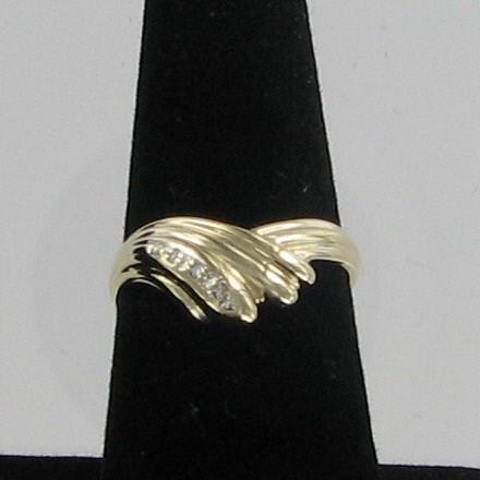 Lady's Diamond Fashion Ring 3 Diamonds .03 Carat T.W. 14K Yellow Gold 2dwt