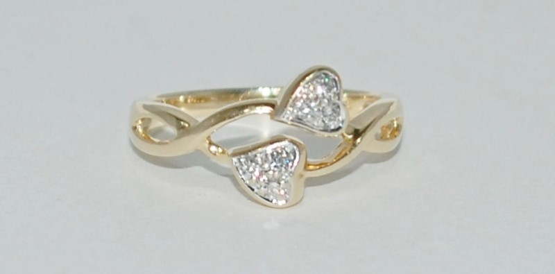 Lady's Diamond Fashion Ring 6 Diamonds .12 Carat T.W. 14K Yellow Gold 2.62g