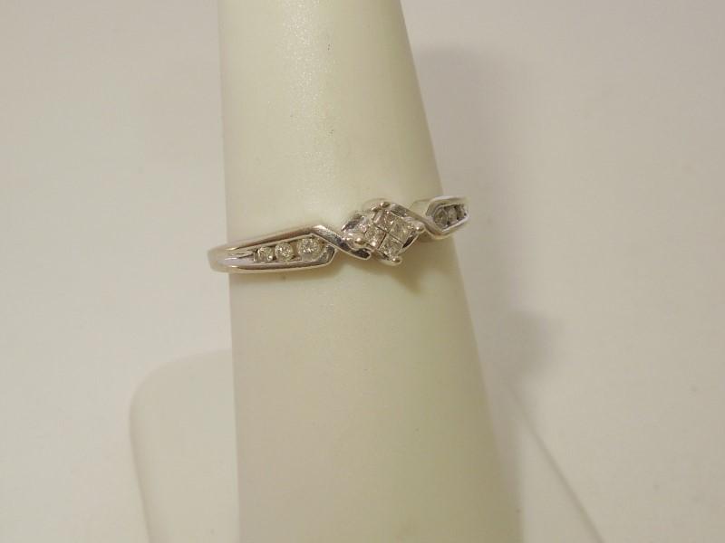 Lady's Diamond Fashion Ring 10 Diamonds .10 Carat T.W. 10K White Gold 2.1g