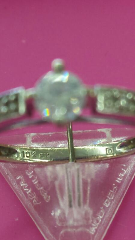 Lady's Diamond Solitaire Ring 9 Diamonds .28 Carat T.W. 10K White Gold 0.99dwt