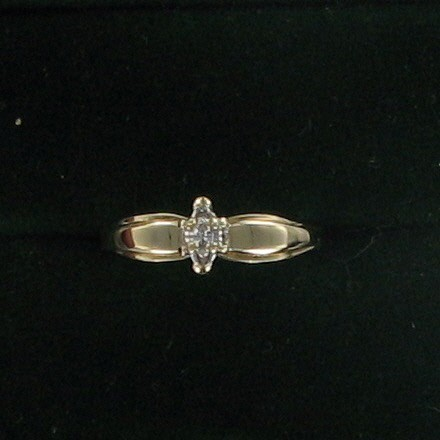 Lady's Diamond Solitaire Ring .05 CT. 10K Yellow Gold 1.5dwt