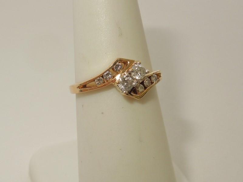 Lady's Diamond Cluster Ring 8 Diamonds .20 Carat T.W. 14K Yellow Gold 2.2g