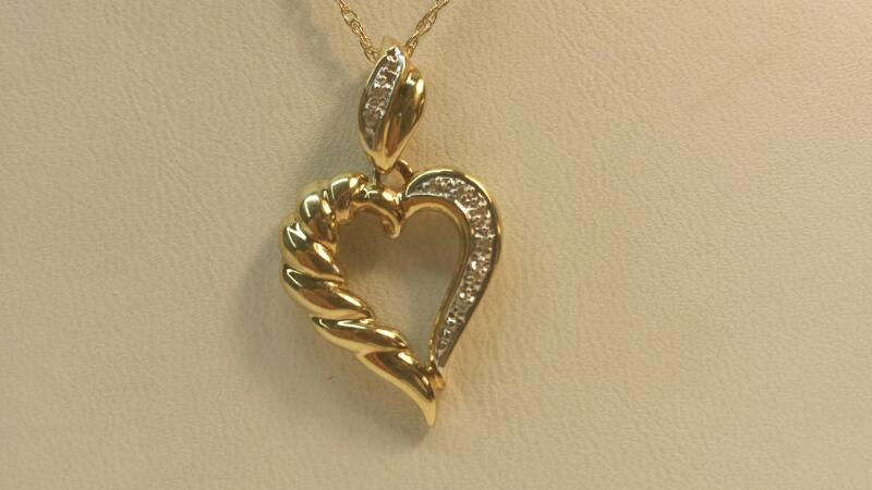 """10k Yellow Gold Heart Pendant and Chain with 9 Diamonds at .09dwt - 18"""""""