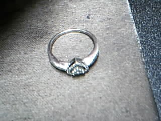 Lady's Diamond Fashion Ring 13 Diamonds .13 Carat T.W. 10K White Gold 1.78g