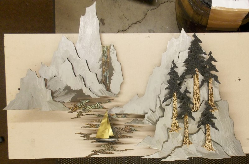 ROSS BENDIXEN 2 PIECE METAL SCULPTURE OF MOUNTAINS, TREES, AND WATERFALL