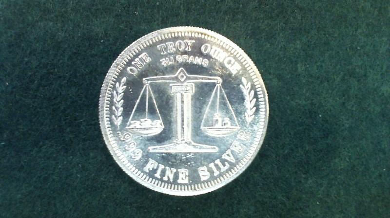 A Silver Bullion .999 SILVER BULLION ONE TROY OUNCE