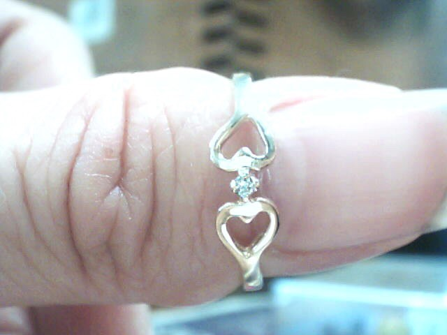 Lady's Diamond Fashion Ring .01 CT. 10K Yellow Gold 1.3dwt