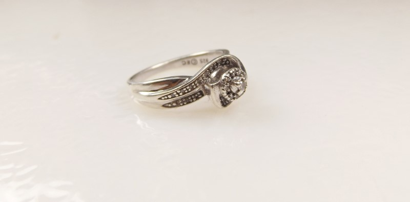 LADY'S STERLING SILVER DIAMOND ENGAGEMENT RING SZ.6.5