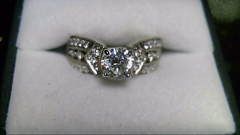 Lady's 14k white gold 1.04ct /with rounds and princess cut dia ring