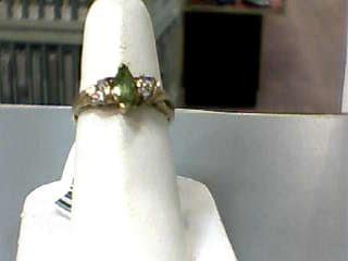 Synthetic Peridot Lady's Stone & Diamond Ring 4 Diamonds .12 Carat T.W.