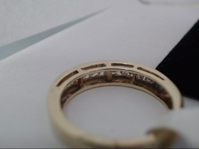 Lady's Diamond Fashion Ring 6 Diamonds .06 Carat T.W. 10K Yellow Gold 3.4g