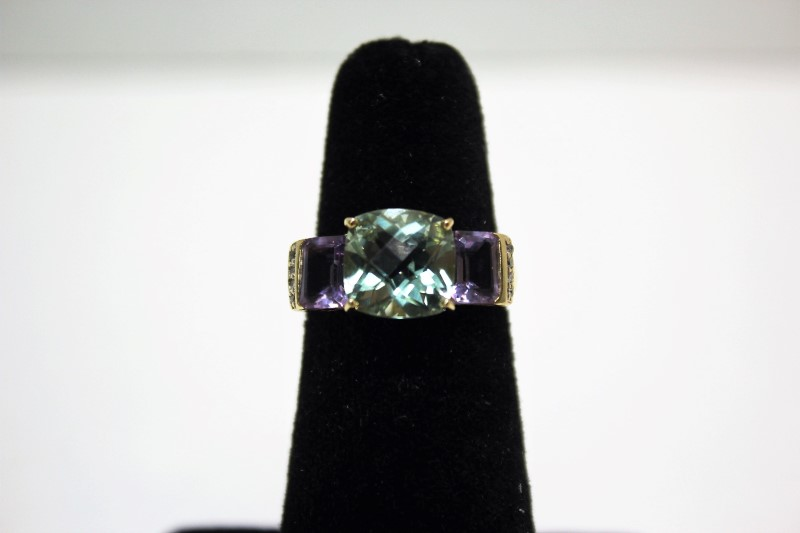 Teal Stone Lady's Stone & Diamond Ring 8 Diamonds .08 Carat T.W.