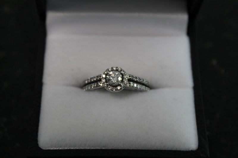 Lady's 14k white gold 1/3ct round halo wed set