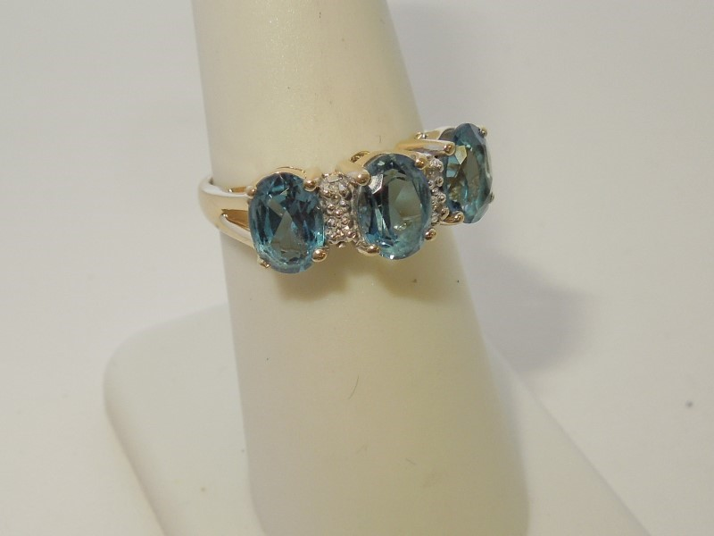 Synthetic Aquamarine Lady's Stone & Diamond Ring 4 Diamonds .020 Carat T.W.