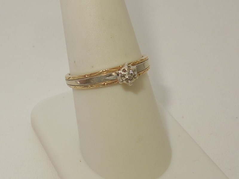 Lady's Diamond Solitaire Ring .02 CT. 14K 2 Tone Gold 2.6g Size:7