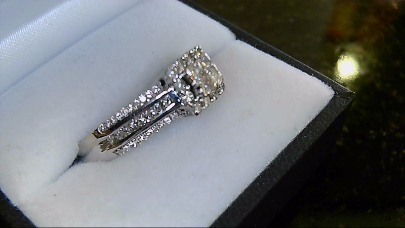 Lady's 14k white and yellow gold princess cut illusion and round diamond ring