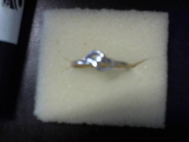Lady's Diamond Solitaire Ring .05 CT. 14K Yellow Gold 2.2g