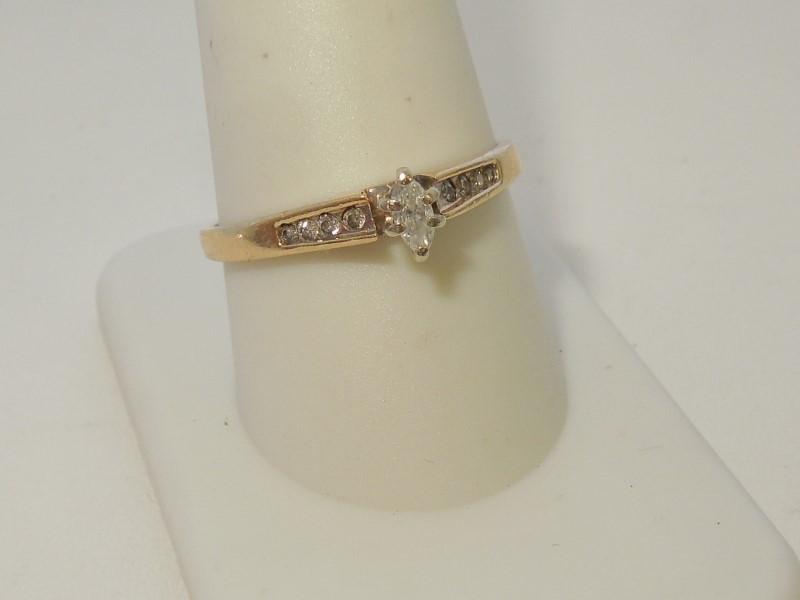 Lady's Diamond Fashion Ring 9 Diamonds .18 Carat T.W. 10K Yellow Gold 2.1g