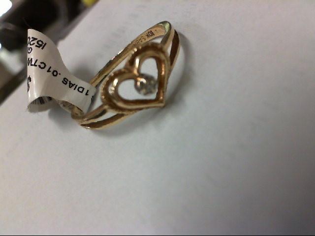 Lady's Diamond Fashion Ring .01 CT. 10K Yellow Gold 1.5g