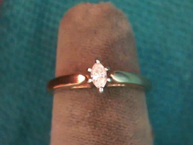 Lady's Diamond Solitaire Ring 3 Diamonds .30 Carat T.W. 10K Yellow Gold 1.5dwt