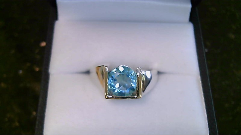 Lady's sterling silver 925 with 14kyg round blue topaz sz 7 ring