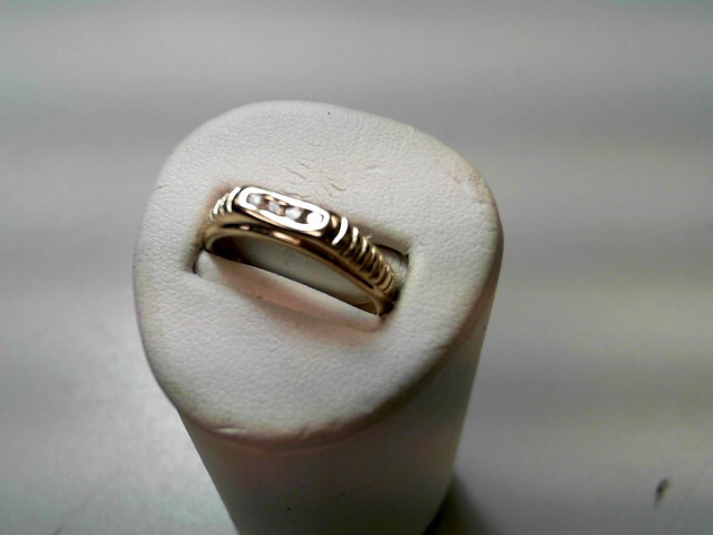 Lady's Diamond Fashion Ring 4 Diamonds .12 Carat T.W. 14K Yellow Gold 2.7g
