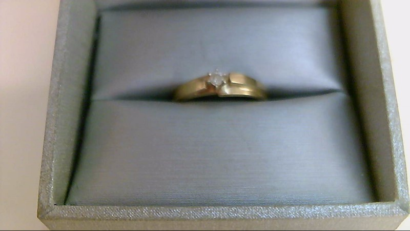Lady's Diamond Solitaire Ring .05 CT. 10K Yellow Gold 1.7g