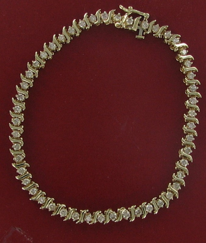 Gold-Diamond Bracelet 47 Diamonds 1.41 Carat T.W. 10K Yellow Gold 5dwt